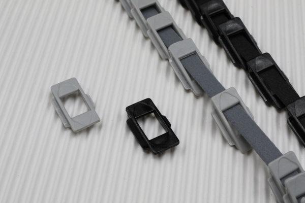 Zugbandführung schwarz oder grau, Lamellenöse